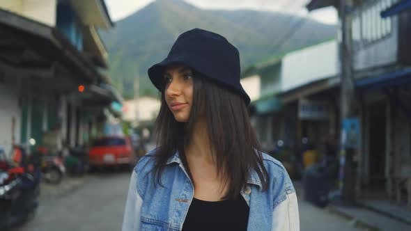 Beautiful Brunette Woman Wearing Black Hat Looking At Camera