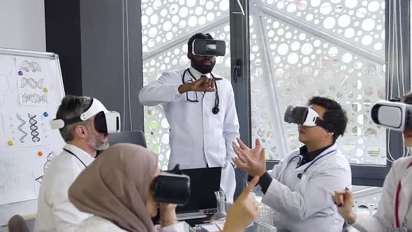 Medical Male and Female Team Using Virtual Reality Technology to Study of Modern Medicine