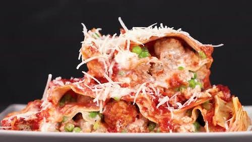 Seasoning lasagna with parmesan cheese
