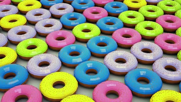 Lots of colored donuts . The camera moves over the background of the donuts