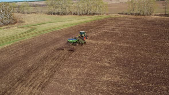 Tractor with seeder in the field.