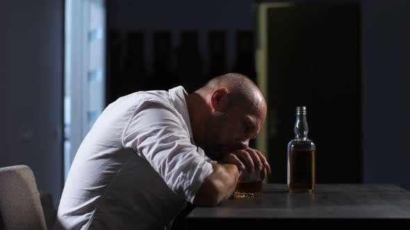 Thumbnail for Lonely Depressed Adult Man Drinking Whisky at Home