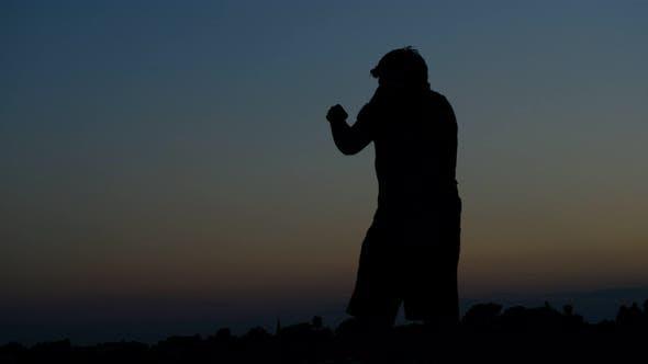 Punching Silhouette Man