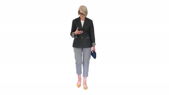 Thumbnail for Intelligent Senior Woman Using Smartphone While Walking on White Background.