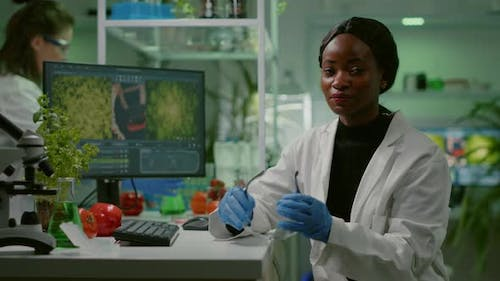 African Scientific Woman Putting Her Medical Glasses