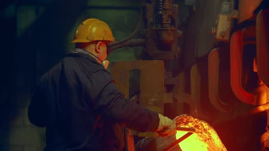 Thumbnail for The worker pours in the form of hot metal. Metalworks