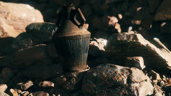 Old Metal Jug at Rocks