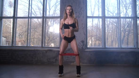 Thumbnail for Sporty Woman Training Thigh Muscles in Studio