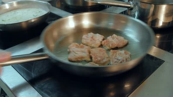 Meat Being Fried in a Frying Pan on the Stove