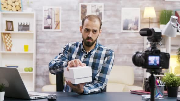 Thumbnail for Famous Young Influencer Recording the Unboxing of a Phone