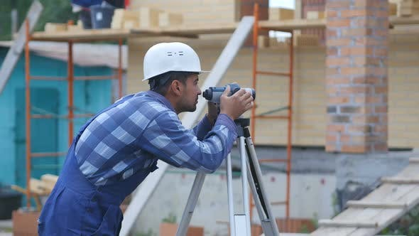 Thumbnail for Surveyor Performs Measuring Operations on the Level and the Theodolite