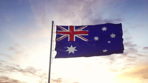 Australia Flag Waving in the Wind Dramatic Sky Background