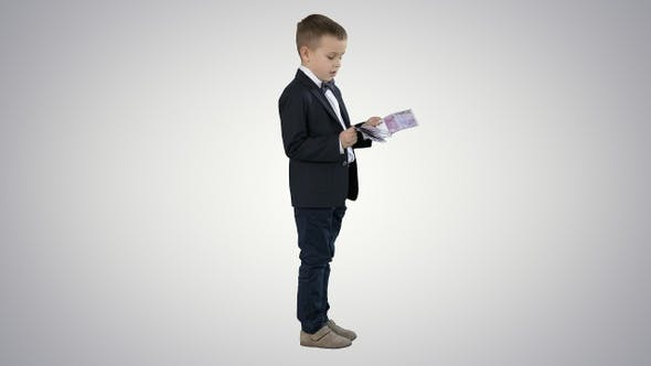 Thumbnail for Little boy in black suit counts money on gradient background