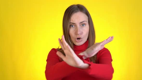 Thumbnail for Displeased Worried Young Woman Posing Isolated on Yellow Background Studio