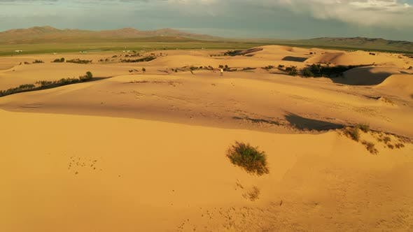 Thumbnail for Aerial View of a Young Man in the Desert on a Sand Dune. Sahara Desert