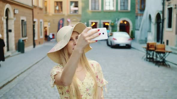 Thumbnail for Girl Sightseeing and Taking Shots. Cheerful Woman Sightseeing and Taking Shots on Old Town Street.