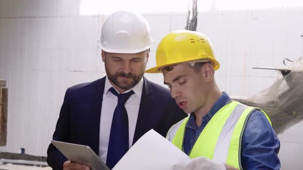 Thumbnail for Male Construction Workers Viewing Documents