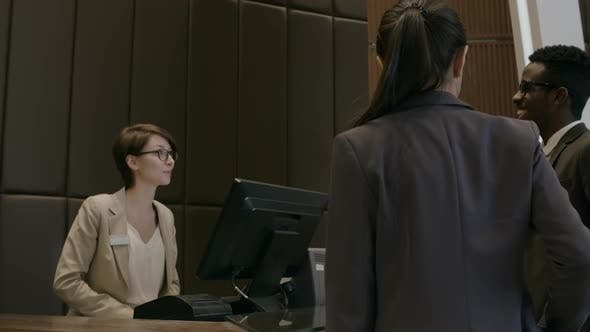 Thumbnail for Receptionist Greeting Business Travelers in Hotel