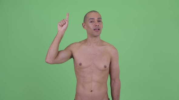 Happy Bald Multi Ethnic Shirtless Man Pointing Up
