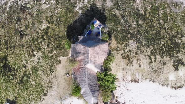 The Rock Restaurant in Ocean Built on Cliff at Low Tide on Zanzibar Aerial Top