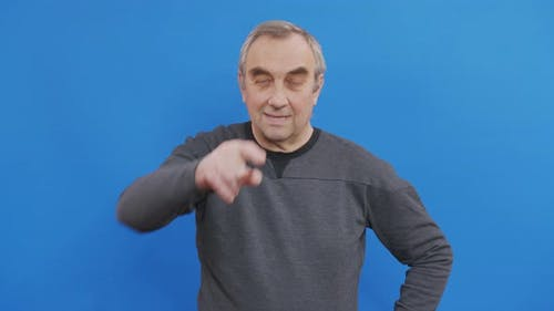 Mature Man Pointing Finger To Camera