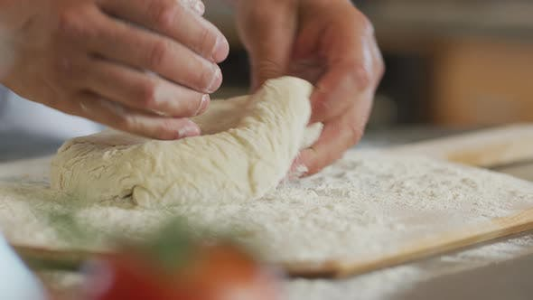 Thumbnail for Close up of hands preparing fresh pizza dough