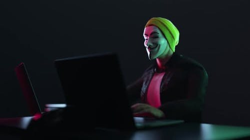 Hacker with Anonymous Mask Work Write the Code