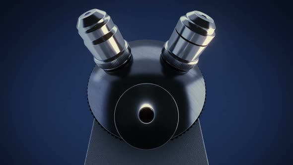 Cover Image for Scientific Laboratory Microscope in Dark Laboratory Changing Its Metal Lenses