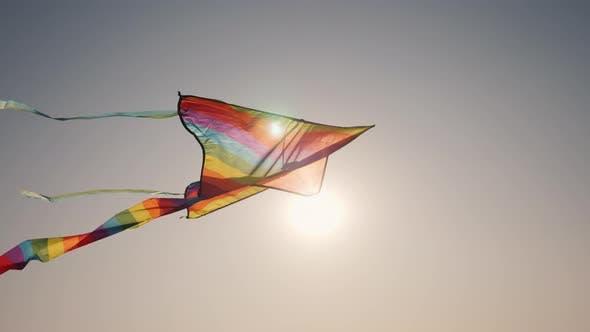 Thumbnail for The Sun Illuminates the Kite That Soars in the Sky