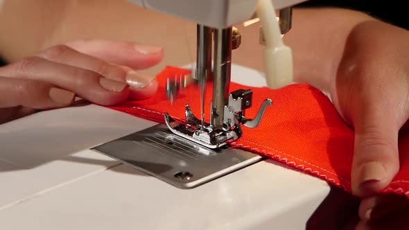 Thumbnail for White Stitch on a Red Fabric. Slow Motion
