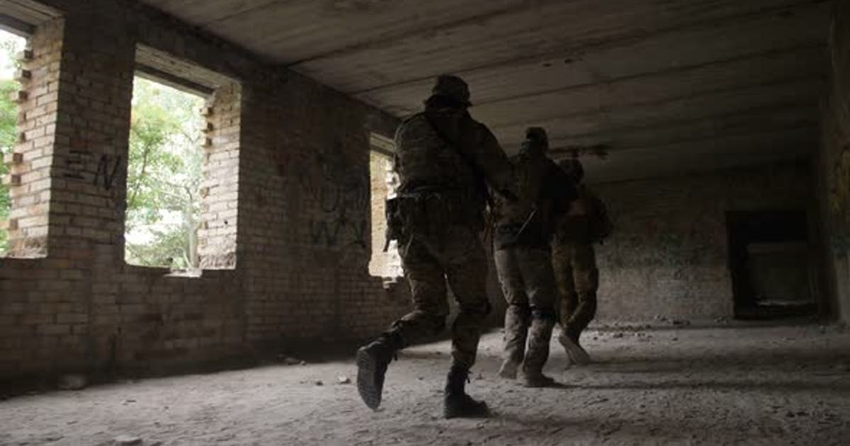 Soldiers Storming the Building Captured By Enemy