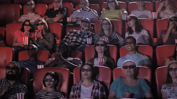 Diverse Lively Audience Watching 3d Movie