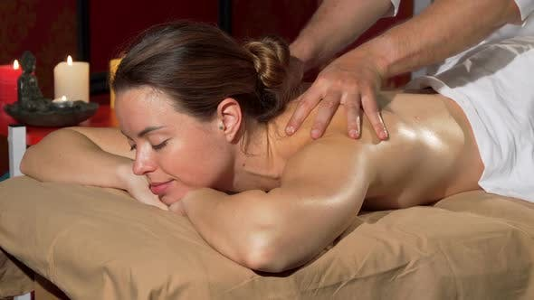Thumbnail for Professional Masseur Performing Back Massage on a Female Client at Spa Center