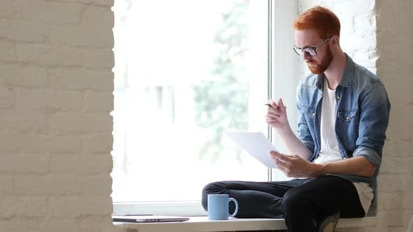Thumbnail for Reading Documents, Paperwork, Relax Man Sitting in Window, Beard