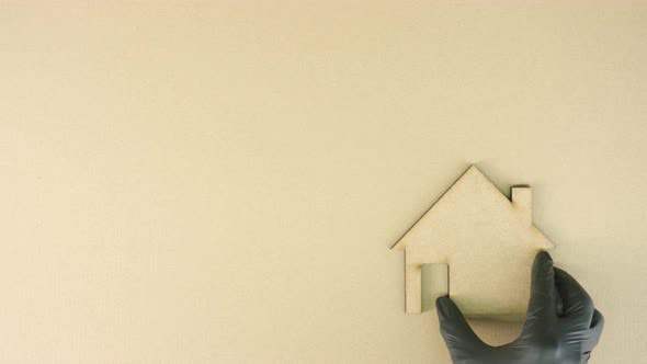 Cardboard House Icon and SUSTAINABLE LIVING Text