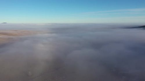 Aerial Drone View of Clouds in a Misty Morning