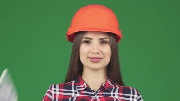 Thumbnail for Beautiful Female Constructionist Smiling Wearing Hardhat