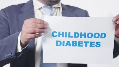 Businessman Posts Sign On Window Childhood Diabetes