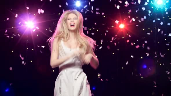 Cover Image for Carefree Girl Are Dancing Against Disco Lights and Glitter Confetti