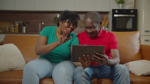 Elderly African Spouses Video Conferencing Online
