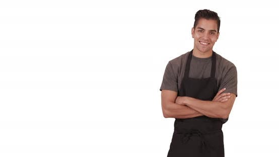 Thumbnail for Happy handsome millennial Latino waiter wearing apron on white background