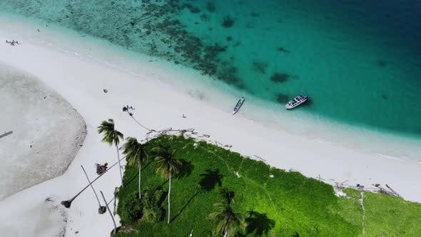 Thumbnail for Cinematic overhead aerial view of a beautiful small island beach in the middle of the ocean