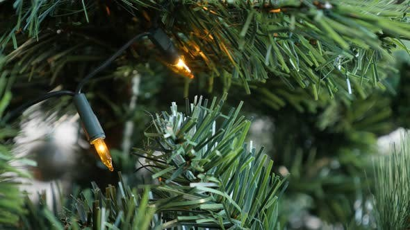 Thumbnail for Beautiful  Christmas tree and warm yellow decorative bulbs  3840X2160 UHD footage - Decorative New Y