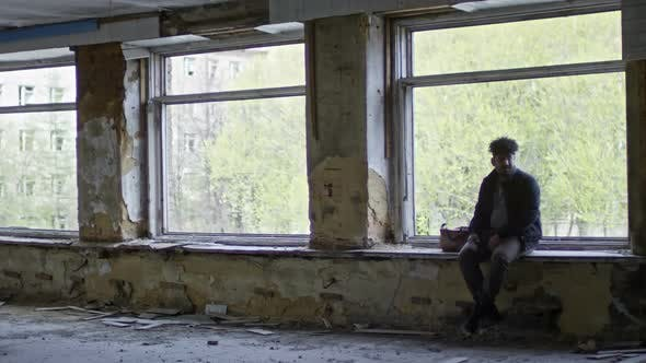 Thumbnail for Arab Man in Abandoned Building