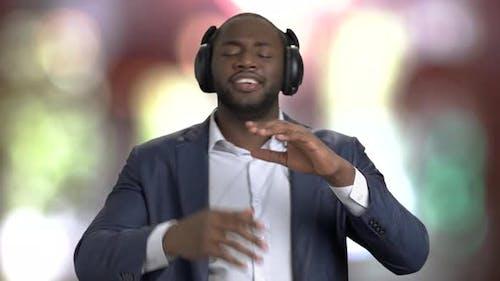 Handsome Businessman Listening To Music in Headphones