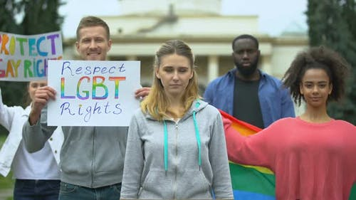 Activists Raising Posters and Rainbow Symbols, Rally March for LGBT Rights
