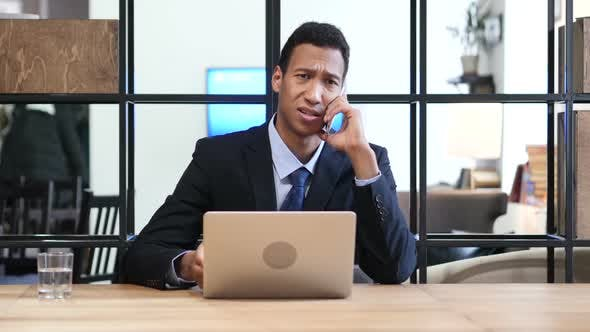 Thumbnail for Phone Negotiation, Black Businessman Working on Laptop