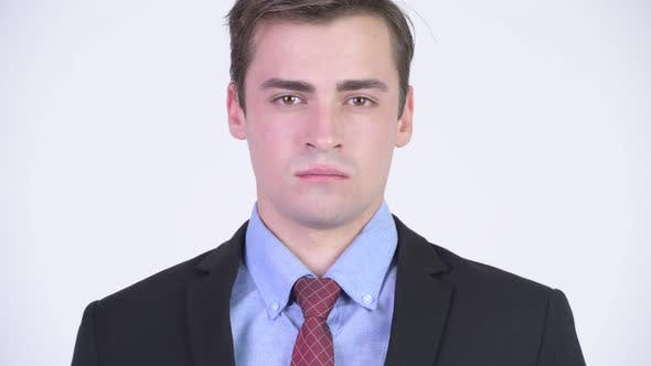 Thumbnail for Head Shot of Young Handsome Businessman Wearing Suit