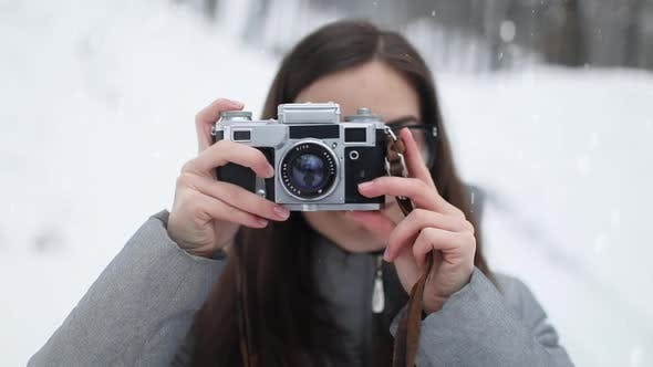 Thumbnail for Portrait of Girl with Vintage Camera Taking Photographs