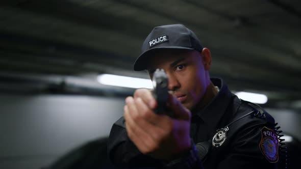 Policeman Aiming Target with Gun